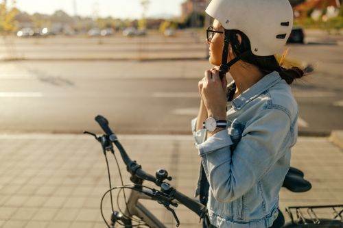 Woman preparing for a bike ride