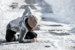 Woman slips and falls on ice